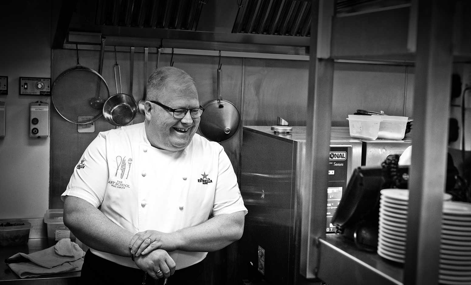 Chef Paul Askew Laughing in the kitchen at The Art School Restaurant About Us